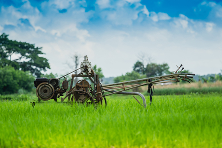 rice mill: Thai Farmer using old tiller tractor Pumping water from underground into the fields. Stock Photo