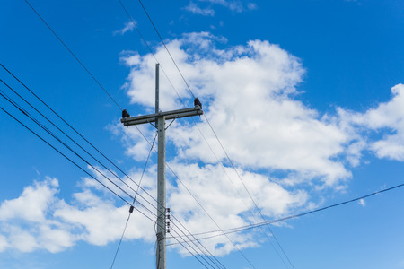 circulate: Electrical poles on white cloud and blue sky. Stock Photo