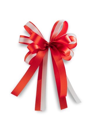 red and white ribbon with bow isolated on white background. File contains a clipping path.