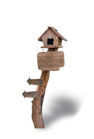Wooden bird house on wooden sign isolated on white background. File contains a clipping path. Stock Photo