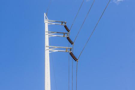 Electrical poles on white cloud and blue sky. Reklamní fotografie