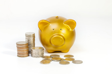 conceptual image, pile of coins close gold piggy bank on white background.