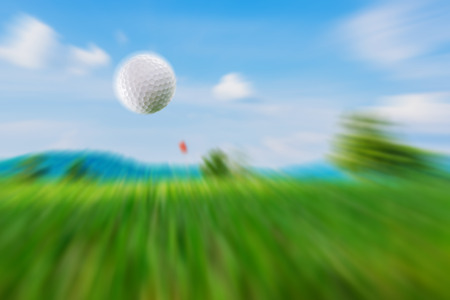 motion of golf white ball were hit to the hole. Stock Photo