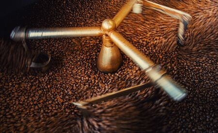 Arabica coffee beans roasted in cooling down after roasted machine, Close-up. Stock fotó