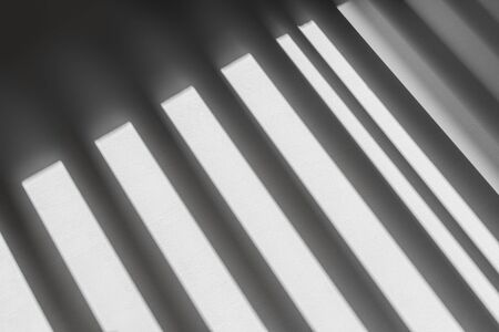 abstract shadow batten of lath and morning light on white concrete wall texture background Stock fotó