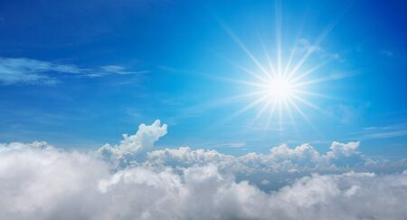 Beautiful of sun shines above the blue sky with clouds in the day
