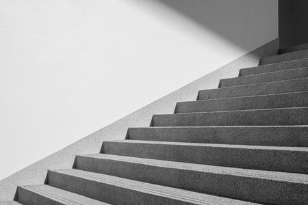 Architectural design of stair concrete with shadow looking at a mirage Black and white. Copy space Stock fotó