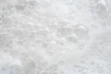 closeup bubbles foam white background from washing Stock Photo