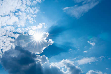 blue sky with clouds and sun shines with sunbeams in the day Reklamní fotografie