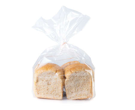 sliced whole wheat bread in plastic bag isolated on white background