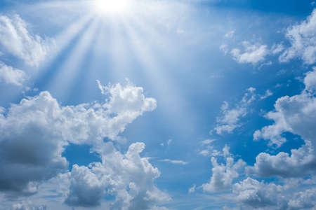 blue sky with clouds and sun shines bright in the day