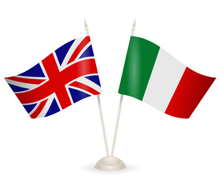 between: Table stand with flags of England and Italy. Symbolizing the cooperation between the two countries.
