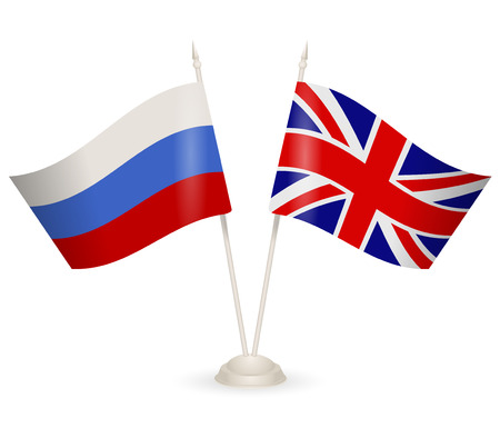 between: Table stand with flags of Russia and  England, Symbolizing the cooperation between the two countries.