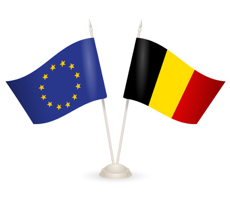 between: Table stand with flags of EU and Belgia. Symbolizing the cooperation between the two countries.