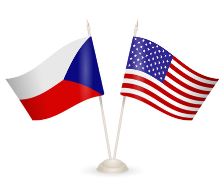 between: Table stand with flags of Chech and USA. Symbolizing the cooperation between the two countries.