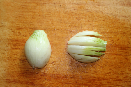 Chopped onions on wooden cutting board. Chopped fresh,
