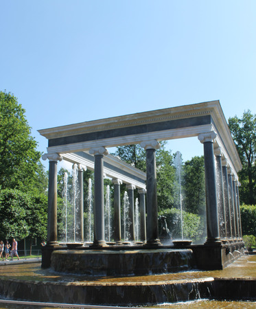 Summer photo of Peterhof. Beautiful fountains in the Park.