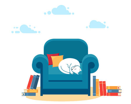 Cute white cat lying on a blue armchair. Concept of recreation and reading.