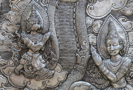 lanna: Decorative Art of Lanna Thai silver carving art on temple wall . Srisuphan temple , Chiang mai, Thailand , (Public area)