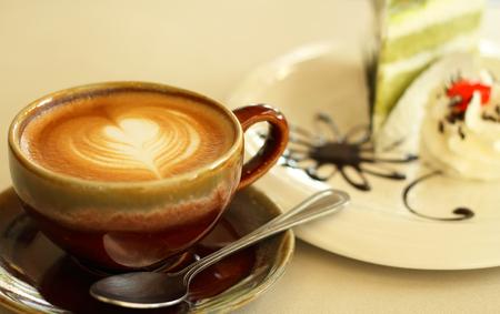 Coffee cup and green tea cake Stock Photo