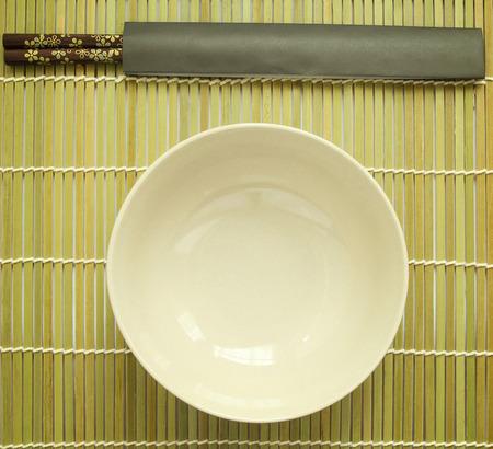 matting: Chopsticks on bamboo matting background