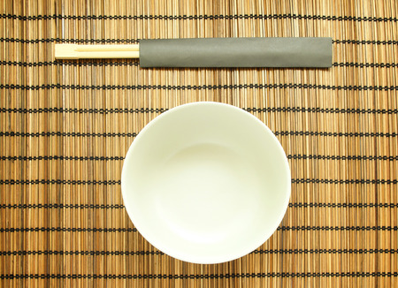 matting: Chopsticks on brown bamboo matting background Stock Photo
