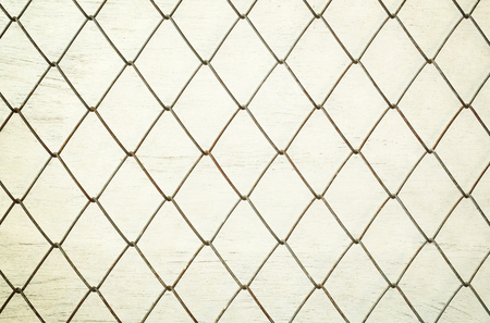 enclose: Metal grid on Background with plywood