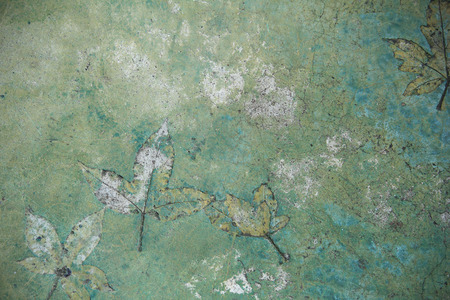 Background and texture with plaster floor leaves pattern