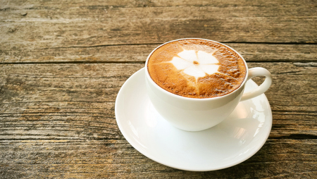 Cup of latte coffee on table Stock Photo - 85437977