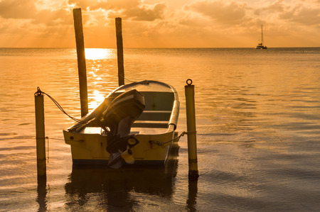 tourism in belize: Majestic sunset in the Caribbean sea by Caye Caulker island, Belize