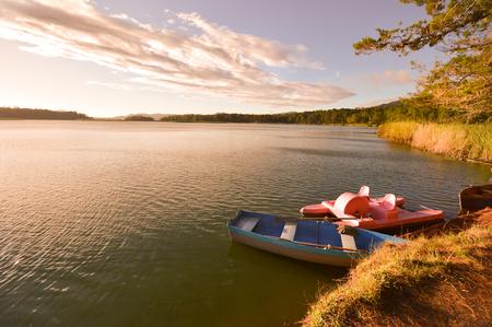 azul: Boats at sunset by the Bosque Azul Lake in the Lagunas de Montebello National Park Chiapas, Mexico Stock Photo