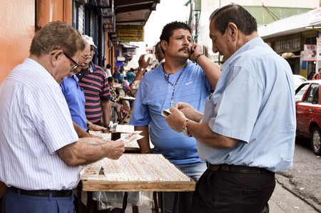 san jose: San Jose, Costa Rica - August 18, 2015: Man buy the lottery tickets in the streets of San Jose in Costa Rica, Central America