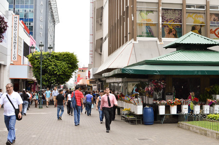 jose: San Jose, Costa Rica - August 18, 2015: People are seen walking down the streets in downtown of San Jose, Costa Rica on August 18, 2015 Editorial