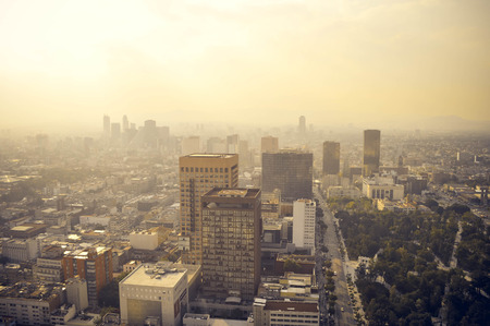 city panorama: Mexico city industrial part covered in haze on sunset seen from the Latin American Tower, Mexico Stock Photo