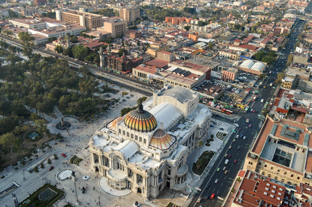 The view of the Palace of Fine Arts in Mexico city and Alameda Central Park seen from the top of the Latin American tower Stock Photo