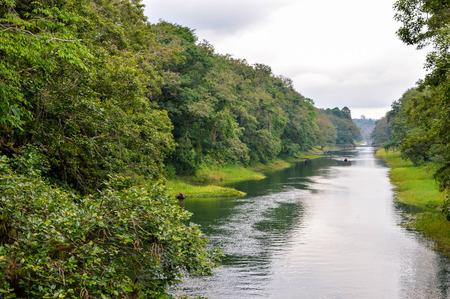 River through Los Naranjos national park with Lake de Yojoa hardly visible through the haze on the background, Honduras