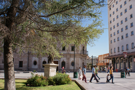 Chihuahua, Mexico - October 8, 2014: People are seen passing the main plaza of the city of Chihuahua, Mexico