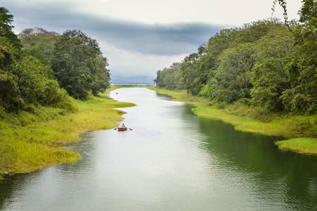 River through Los Naranjos national park with Lake de Yojoa hardly visible through the haze on the background, Honduras. Central America