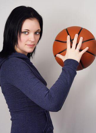 basket ball: Ni�a con baloncesto Foto de archivo