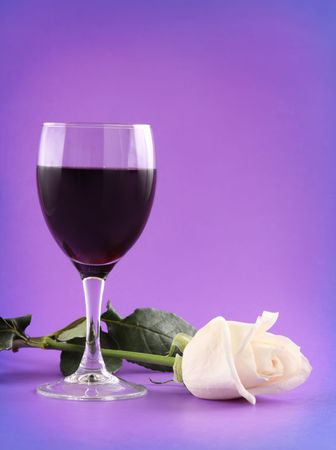 white wine: glass of red wine and white rose