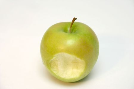 green apple with a bite missing