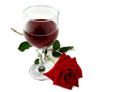 glass of red wine and a red rose