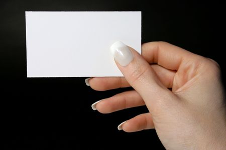Feminine hand holding a blank card Imagens