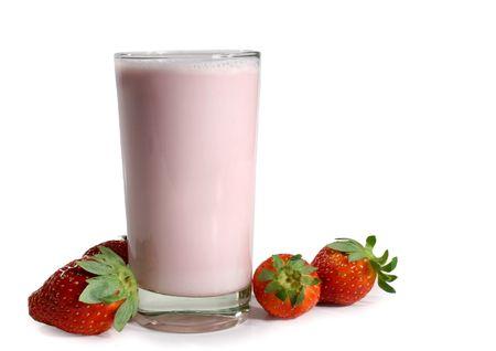 strawberry milkshake with fresh fruit isolated on white background