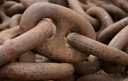 rusty chain: closeup on a big old rusty chain