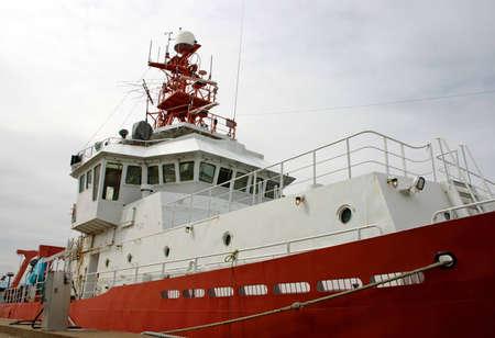 wheelhouse: closeup on a red and white vessel