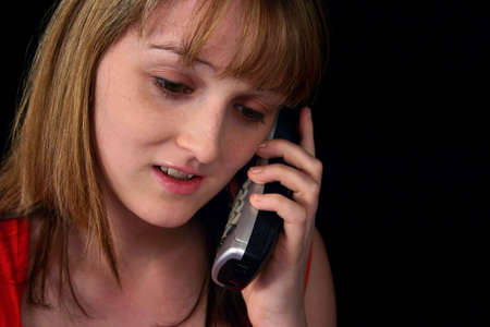 nice looking: Portrait of a nice looking young woman with telephone Stock Photo