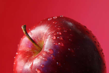 closeup on delicious red apple with waterdrops photo