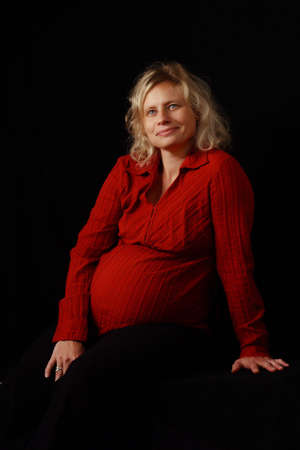 awaiting: portrait of a pregnant blond woman