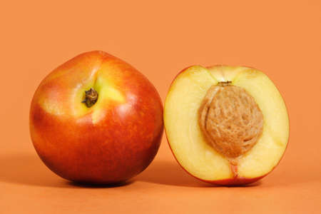 two and a half: two nectarines with peach background